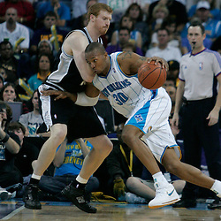29 March 2009: \stp30n\ drives past San Antonio Spurs forward Matt Bonner (15) during a 90-86 victory by the New Orleans Hornets over Southwestern Division rivals the San Antonio Spurs at the New Orleans Arena in New Orleans, Louisiana.