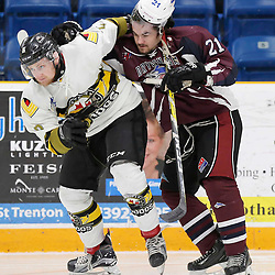 "TRENTON, ON  - MAY 3,  2017: Canadian Junior Hockey League, Central Canadian Jr. ""A"" Championship. The Dudley Hewitt Cup. Game 3 between the Powassan Voodoos and the Dryden GM Ice Dogs.  Justin Schebel #2 of the Powassan Voodoos and  Derek McPhail #21 of the Dryden GM Ice Dogs  battle during the first period <br /> (Photo by Amy Deroche / OJHL Images)"