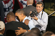 Pete Souza (Right), current Chief Official White House photographer for President Barack Obama, Director of the White House Photography Office and Assistant Professor at Ohio University's School of Visual Communication, photographs President Obama at a re- election rally on the Athens Campus of Ohio University on October 17, 2012.