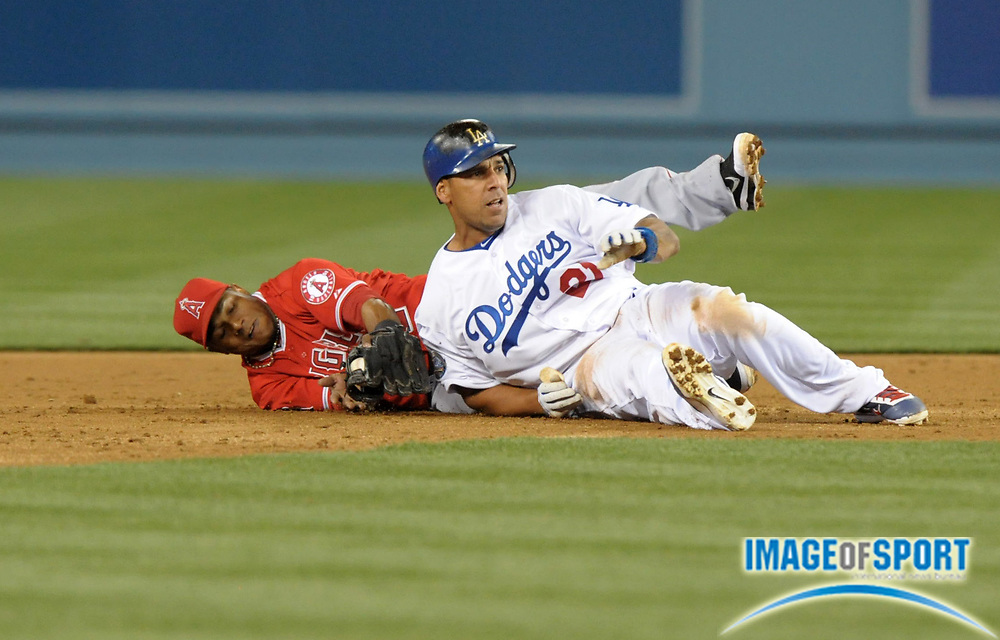 Apr 3, 2012; Los Angeles, CA, USA; Los Angeles Angels shortstop Erick Aybar (2) tags out Los Angels Dodgers right fielder Juan Rivera (21) at second base in the third inning at Dodger Stadium.