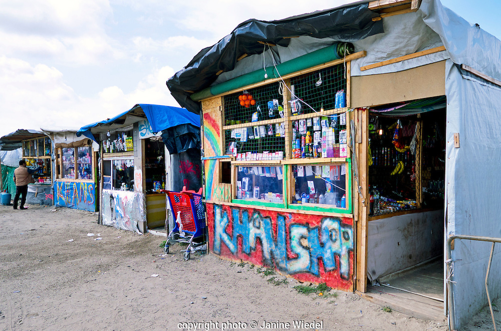 Enterprising shops continually changing inside The Calais Jungle Refugee and Migrant Camp in France