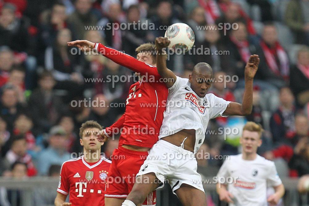 15.02.2014, Allianz Arena, Muenchen, GER, 1. FBL, GER, 1. FBL, FC Bayern Muenchen vs SC Freiburg, 21. Runde, im Bild l-r: im Zweikampf, Aktion, Kopfballduell mit Toni KROOS #39 (FC Bayern Muenchen), Gelson FERNANDES #4 (SC Freiburg) // during the German Bundesliga 21th round match between FC Bayern Munich and SC Freiburg at the Allianz Arena in Muenchen, Germany on 2014/02/15. EXPA Pictures &copy; 2014, PhotoCredit: EXPA/ Eibner-Pressefoto/ Kolbert<br /> <br /> *****ATTENTION - OUT of GER*****