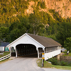 A covered bridge over the Ammonoosuc River in Stark, New Hampshire.