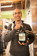 Narendra Varma gets a growler filled on opening day of Green Zebra Grocery in Portland Oregon