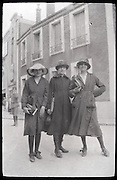 three young adult self assured girls early 1900s