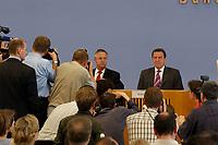 26 JUL 2003, BERLIN/GERMANY:<br /> Hans Eichel (L), SPD, Bundesfinanzminister, Gerhard Schroeder (R), SPD, Bundeskanzler, Fotografen und Kameraleute, Pressekonferenz ueber die Umsetzung der Agenda 2010 und  dem Vorziehen der Steuerreform, Bundespressekonferenz<br /> IMAGE: 20030716-02-015<br /> KEYWORDS: Gerhard Schröder, Journalist, Journalisten, Kamera, Camera, Fotograf