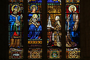 Bishop Graveran, followed by St Joseph, offering the cathedral spires to the Virgin Mary and St Corentin, stained glass window, Bay 21, in the Chapelle de Saint-Pierre, Quimper Cathedral, or the Cathedrale Saint-Corentin de Quimper, a Gothic Roman Catholic cathedral founded in 1239 and completed in the 15th century, in Quimper, Finistere, Brittany, France. The window was made in 1856 by Lobin of Tours, 1814-64, and celebrates the restoration of the cathedral's spires at the time of Monseigneur Joseph Marie Graveran. The window was a gift to the cathedral from Mme Mascarene de Riviera. The cathedral is listed as a national monument. Picture by Manuel Cohen