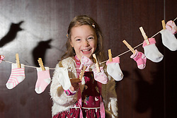 Repro Free: 14/11/2014 <br /> Little heroes &ldquo;sock it&rdquo; to &lsquo;em for World Prematurity Day<br /> Little hero Saoirse Madden (5) from Ballincollig Co. Cork is pictured showing how much she has grown out of the socks they wore as premature babies. They were celebrating the upcoming World Prematurity Day on Monday 17th November at an event hosted by the Irish Neonatal Health Alliance and supported by AbbVie.  Picture Andres Poveda