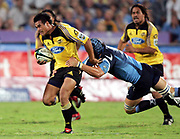 Hurricanes fullback Isaia Toeava in action during the Super 14 rugby union match between the Bulls and Hurricanes at Loftus Pretoria, South Africa, on Friday 17 March, 2006. The Hurricanes won the match 26-23. Photo: Africa Visuals/PHOTOSPORT **NZ USE ONLY**<br /> <br /> <br /> 149909