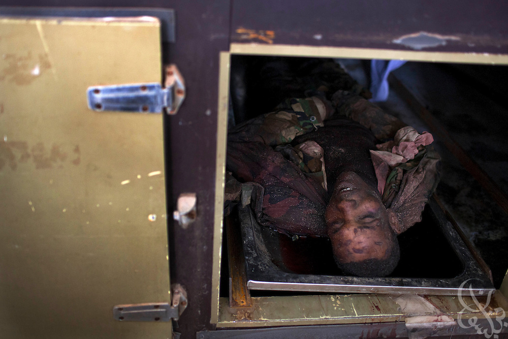 The body of a suspected foreign militia fighter lies in a morgue refrigerator February 24, 2011 at the al Jala'a hospital in Benghazi, Libya. Libyan leader Muammar el-Qaddafi has been accused of using foreign fighters against his people in a desperate attempt to stay in power..Slug: Libya.Credit: Scott Nelson for the New York Times