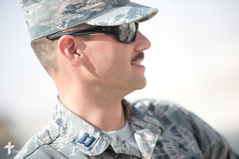 Air Force Capt. Joseph Eggleston, chaplain, 386th Air Expeditionary Wing, visits security personnel on Monday, March 23, 2015. LCMS Communications/Erik M. Lunsford
