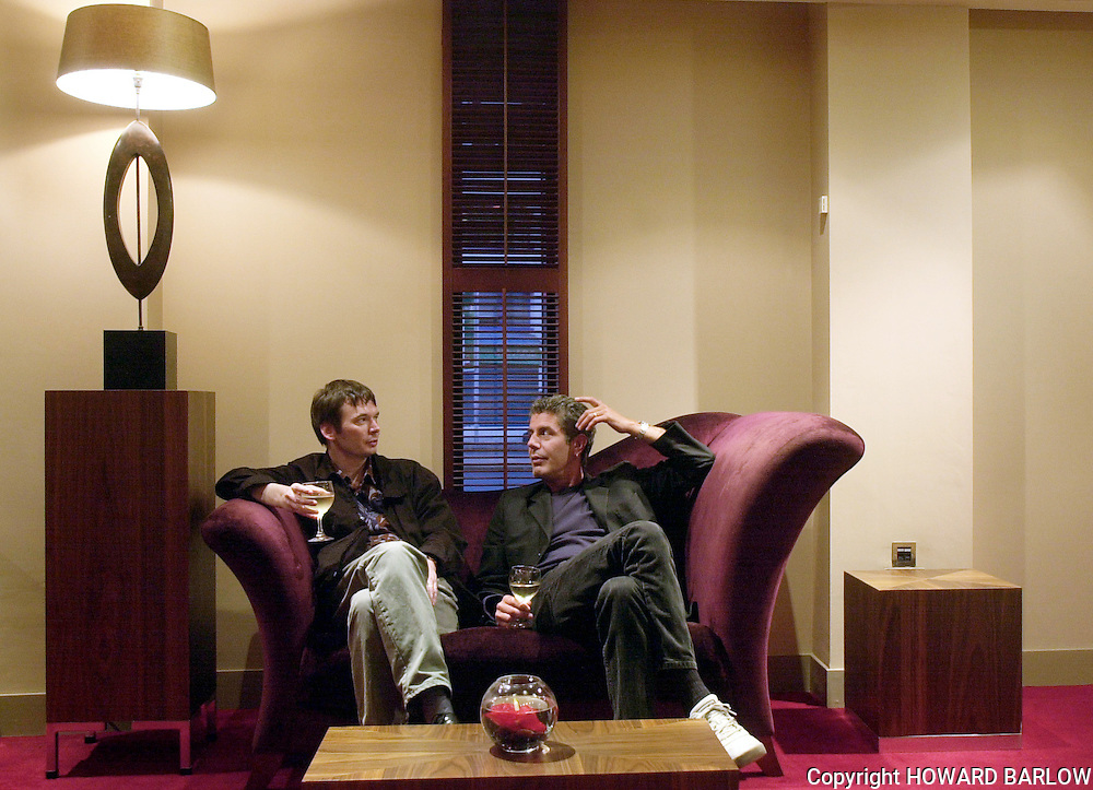 PHOTOGRAPH BY HOWARD BARLOW..WRITERS IAN RANKIN (left) and ANTHONY BOURDAIN in conversation in a Manchester bar