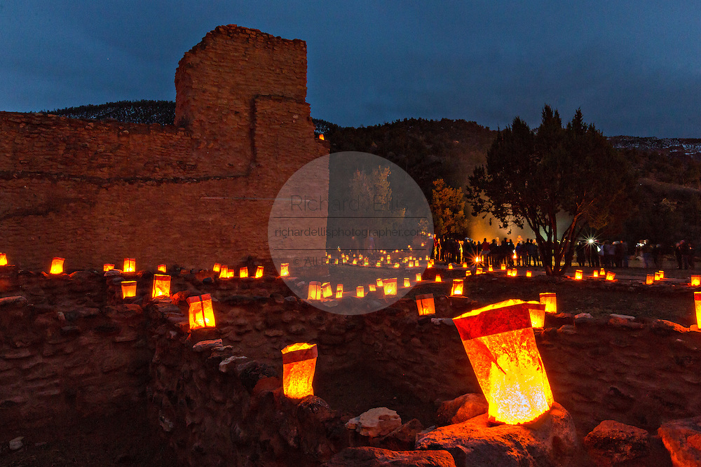 The ruins of the San José de los Jémez Mission part of the Jemez Historic Site is illuminated by hundreds of small paper lanterns known as luminaria to celebrate the holiday season December 12, 2015 in Jemez Springs, New Mexico. The site is in the Jémez Indian pueblo and contains an early 17th-century mission complex.