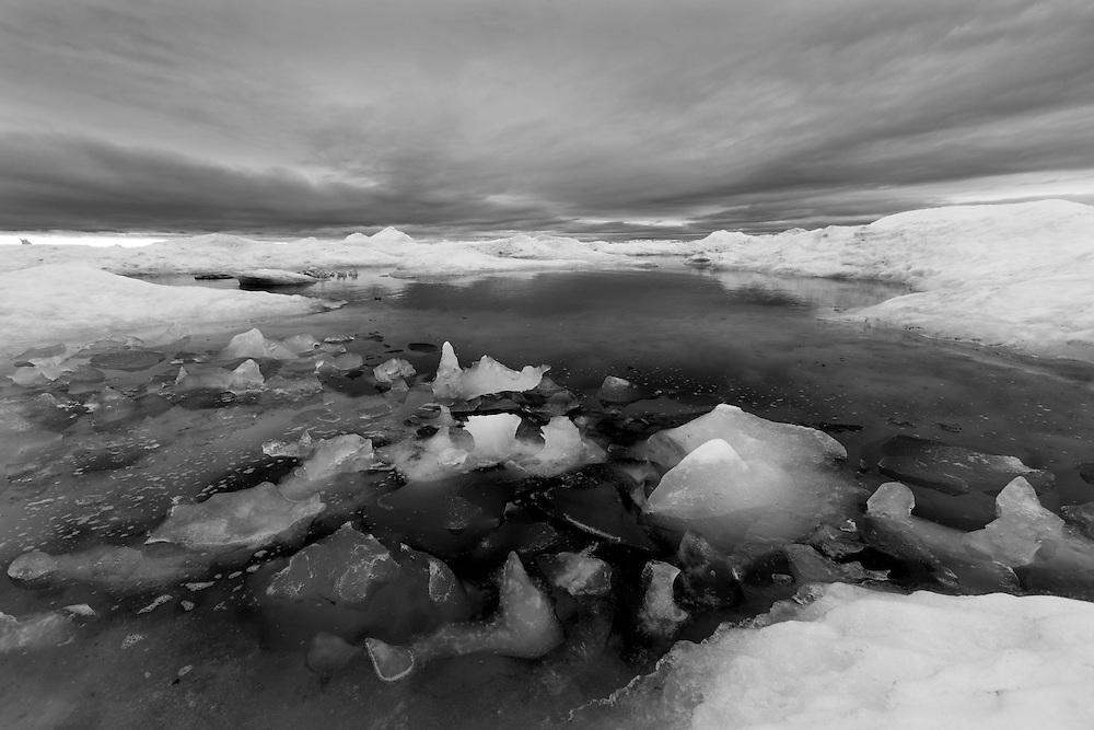 Canada, Manitoba, Churchill, Melting sea ice on Hudson Bay on overcast summer morning