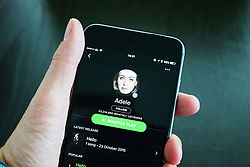 Spotify online music streaming app showing Adele on an iPhone 6 plus smart phone
