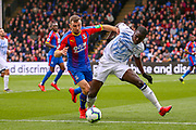 Crystal Palace midfielder James McArthur (18) tussles with Everton defender Kurt Zouma (5) during the Premier League match between Crystal Palace and Everton at Selhurst Park, London, England on 27 April 2019.
