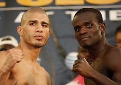 June 12, 2009; New York, NY, USA;  WBO Welterweight Champion Miguel Cotto (l) and Joshua Clottey (r) weigh in for their upcoming fight. The two will meet on June 13, 2009 at Madison Square Garden.  Mandatory Credit: Ed Mulholland-US PRESSWIRE