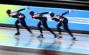 The U.S. Women's Team Pursuit Speed Skating team races around a corner during a finals matchup against the Netherlands at the Oval Lingotto in Turin, Italy on Thursday February 16, 2006. The U.S. men finished 6th in the event and the U.S. women finished 5th. The U.S. women beat the Netherlands..(Photo by Marc Piscotty / © 2006)