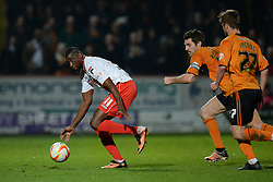 Stevenage's forward Lucas Akins stumbles whilst he runs with the ball  - Photo mandatory by-line: Mitchell Gunn/JMP - Tel: Mobile: 07966 386802 01/04/2014 - SPORT - FOOTBALL - Broadhall Way - Stevenage - Stevenage v Wolverhampton Wanderers - League One