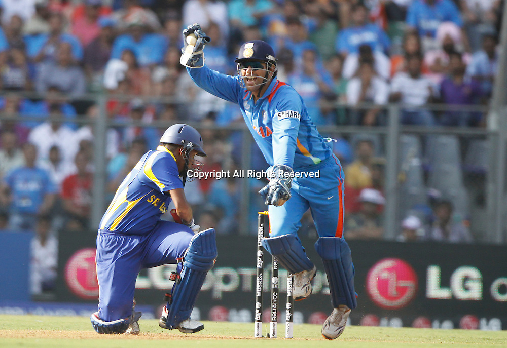 02.04.2011 Cricket World Cup Final from the Wankhede Stadium in Mumbai. Sri Lanka v India. Indian Captain Mahendra Singh Dhoni appeals unsuccessfully during the final match of the ICC Cricket World Cup between India and Sri Lanka on the 2nd April 2011