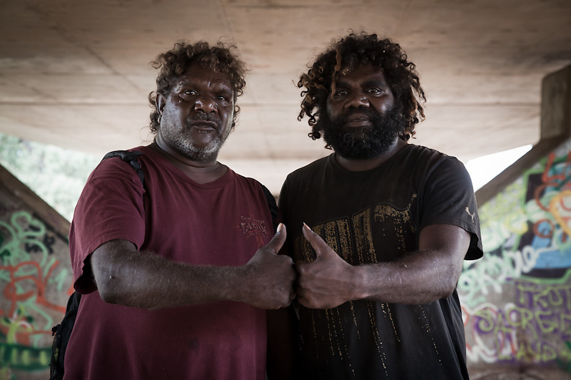 Mervin Wilson singer for Papunya Desert Reggae Band and Barnabas, singer for the Tjupi Band also from Papunya.<br /> Under the bridge with friends and family. Trying to return to Papunya after the Fotty was canceled.