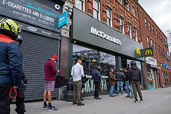 © Licensed to London News Pictures. 13/05/2020. London, UK. Delivery drivers wait outside the Harrow McDonald's. McDonald's has reopened 15 stores in the south east for delivery only service through Uber Eats. Photo credit: Peter Manning/LNP