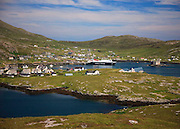 Castlebay, Isle of Barra with the Caledonian Macbrayne vessel MV Clansman bethed at pier.