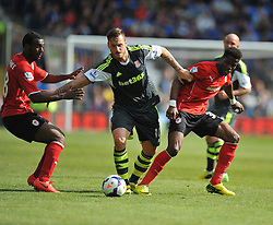 Stoke City's Marko Arnautovic battles for the ball with Cardiff City's Wilfred Zaha and Cardiff City's Kevin Theophile Catherine - Photo mandatory by-line: Alex James/JMP - Mobile: 07966 386802 19/04/2014 - SPORT - FOOTBALL - Cardiff - Cardiff City Stadium - Cardiff City v Stoke City - Barclays Premier League