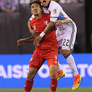 EAST RUTHERFORD, NEW JERSEY - JUNE 17:  Jose Paolo Guerrero #9 of Peru is held by Jeison Murillo #22 of Colombia during the Colombia Vs Peru Quarterfinal match of the Copa America Centenario USA 2016 Tournament at MetLife Stadium on June 17, 2016 in East Rutherford, New Jersey. (Photo by Tim Clayton/Corbis via Getty Images)