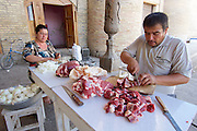 Uzbekistan, Khiva, Dekhon Bazaar.<br /> Cutting meat and onions to fill Somsa (dumplings baked in a tandyr oven).