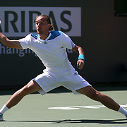 March 12, 2014 Indian Wells, California. Alexandr Dolgopolov defeats Fabio Fognini in a fourth round match at the 2014 BNP Paribas Open. (Photo by Billie Weiss/BNP Paribas Open)