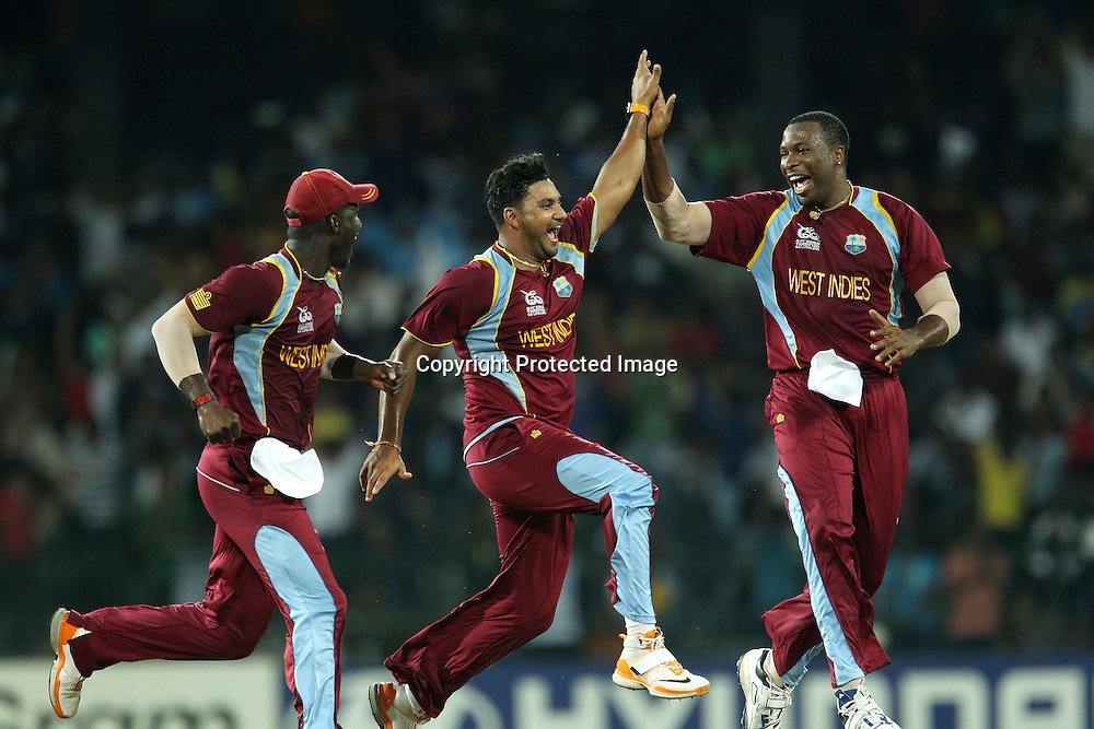 Ravi Rampaul of The West Indies and Darren Sammy (Captain) of The West Indies celebrates the wicket of Cameron White with Kieron Pollard of The West Indiesduring the ICC World Twenty20 semi final match between Australia and The West Indies held at the Premadasa Stadium in Colombo, Sri Lanka on the 5th October 2012<br /> <br /> Photo by Ron Gaunt/SPORTZPICS