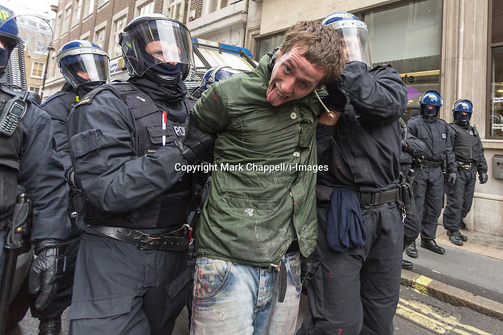 Police detain a protestor following the occupation of a house on Beak St, Soho during the J11 protest in central London by the StopG8 anti-capitalist movement.  Tuesday 11  June  2013.  London, UK.<br /> Photo by: Mark Chappell/i-Images
