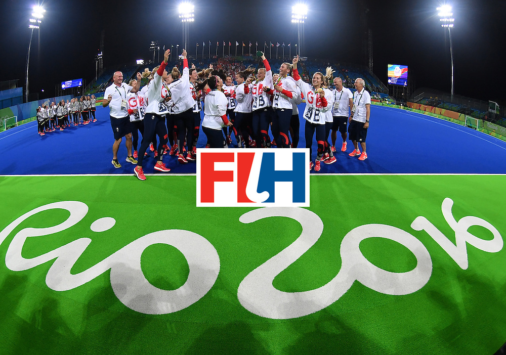 Britain's players pose with their gold medals during the women's field hockey medals ceremony of the Rio 2016 Olympics Games at the Olympic Hockey Centre in Rio de Janeiro on August 19, 2016. / AFP / MANAN VATSYAYANA        (Photo credit should read MANAN VATSYAYANA/AFP/Getty Images)