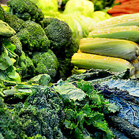 Broccoli, Lettuce, Corn Cobs and Carrots at Farmers Market in Vancouver, Canada
