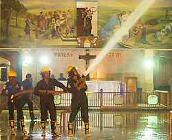 April 27, 2019 - Colombo, Sri Lanka - Sri Lankan firefighters use pressurized water to clean the ceiling and walls  of St. Anthony's Church where an explosion took place in Kochchikade, Colombo, Sri Lanka on 27 April 2019. (Credit Image: © Tharaka Basnayaka/NurPhoto via ZUMA Press)