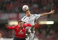 Photo: Lee Earle.<br /> Barnsley v Swansea City. Coca Cola League 1. Play off Final. 27/05/2006. Barnsley's Brian Howard (L) clashes with Owain Tudur-Jones.