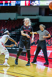 NORMAL, IL - November 20:  Referee Molly Caldwell watches the action as Gabby Nikitinaite passes the ball when challenged by Tete Maggett during a college women's basketball game between the ISU Redbirds and the Huskies of Northern Illinois November 20 2019 at Redbird Arena in Normal, IL. (Photo by Alan Look)