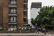 London, England, UK, June 5 2018 - Nearly one year on June 14 2017 fire, Grenfell Tower is covered in a protective wrap supported by scaffolding and will be taken down.