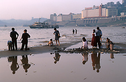 CHINA SICHUAN PROVINCE CHONGQUING MAY99 - People stand on the shore of the Yangtse river where it merges with the Jailing river. Seven large cities, including Chongquing, and thousands of villages will be submerged once the water level rises after the completion of the controversial Three Gorges Dam project further downriver. The flooding of areas reaching back more than 550Km upriver will require the evacuation and resettlement of more than 10 million people.  jre/Photo by Jiri Rezac. © Jiri Rezac 1999. . Contact: +44 (0) 7050 110 417. Mobile:  +44 (0) 7801 337 683. Office:  +44 (0) 20 8968 9635. . Email:   jiri@jirirezac.com. Web:     www.jirirezac.com