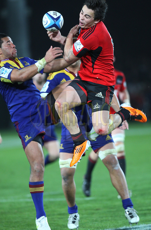 Zac Guildford goes for the high ball. in action.Crusaders v Highlanders, Investec Super Rugby, Trafalgar Park, Nelson. 23 April 2011. Photo: Evan Barnes/photosport.co.nz
