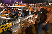 Arkansas Democrat-Gazette/BENJAMIN KRAIN --9/14/2013--<br /> A pit crew member wishes the driver good luck as he approaches the track while competing for $5000 in the White County Fair Demolition Derby