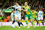 Norwich City forward Teemu Pukki (22)  and Blackburn Rovers defender Lewis Travis (27)   during the EFL Sky Bet Championship match between Norwich City and Blackburn Rovers at Carrow Road, Norwich, England on 27 April 2019.