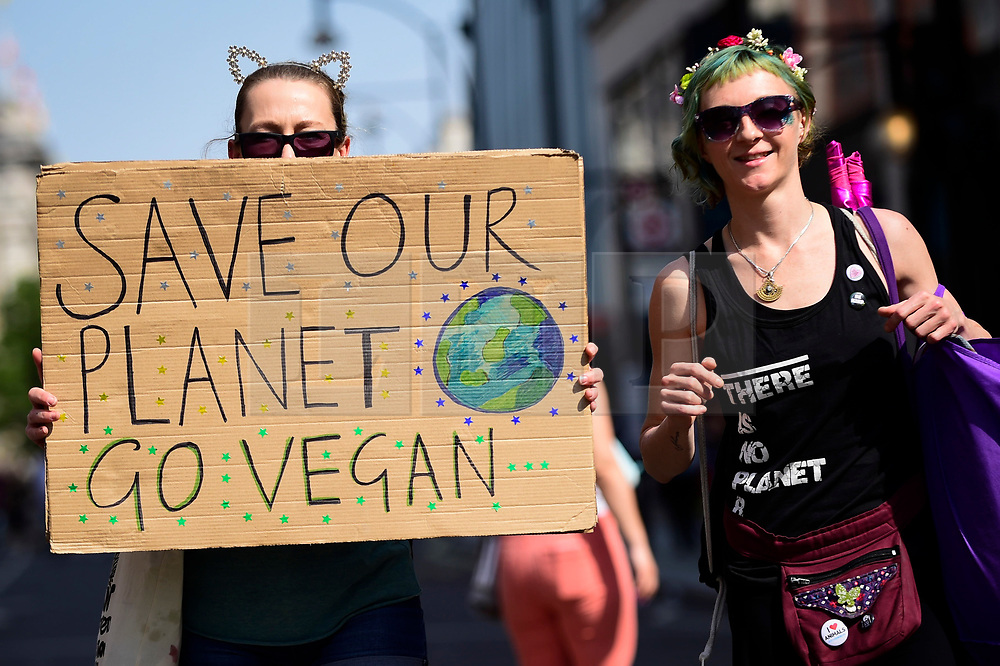 """© Licensed to London News Pictures. 22/04/2019. LONDON, UK.  Activists walk down Oxford Street to Marble Arch during """"London: International Rebellion"""", on day eight of a protest organised by Extinction Rebellion.  Protesters are demanding that governments take action against climate change.  After police issued section 14 orders at the other protest sites of Oxford Circus, Waterloo Bridge and Parliament Square resulting in over 900 arrests, protesters have convened at the designated site of Marble Arch so that the protest can continue.  Photo credit: Stephen Chung/LNP"""