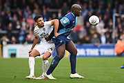 Peterborough United defender Niall Mason (24) battles for possession  with Wycombe Wanderers striker Adebayo Akinfenwa (20) during the EFL Sky Bet League 1 match between Wycombe Wanderers and Peterborough United at Adams Park, High Wycombe, England on 5 October 2019.