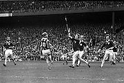 07/09/1975<br /> 09/07/1975<br /> 7 September 1975<br /> All-Ireland Hurling Final: Kilkenny v Galway at Croke Park, Dublin. <br /> Kilkenny's right half forward, Mick Crotty (10), hits the ball over the Galway defenders to score a point.<br /> The Galway full-back player in the center is Joe Clarke.