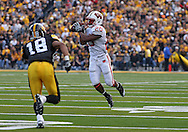 October 23 2010: Wisconsin Badgers running back James White (20) pulls in a pass in front of Iowa Hawkeyes cornerback Micah Hyde (18) during the first half of the NCAA football game between the Wisconsin Badgers and the Iowa Hawkeyes at Kinnick Stadium in Iowa City, Iowa on Saturday October 23, 2010. Wisconsin defeated Iowa 31-30.