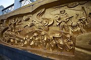 Dien Bien Phu Cemetery for fallen Viet Minh soldiers. Relief with battle scenes at the entrance.