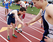 Josh Goldstein of Webster Thomas, left, shakes hands with Drew Schmitt of Brighton after the 1,600-meter run at the His and Her track and field invitational at Penfield High School on Saturday, April 26, 2014.
