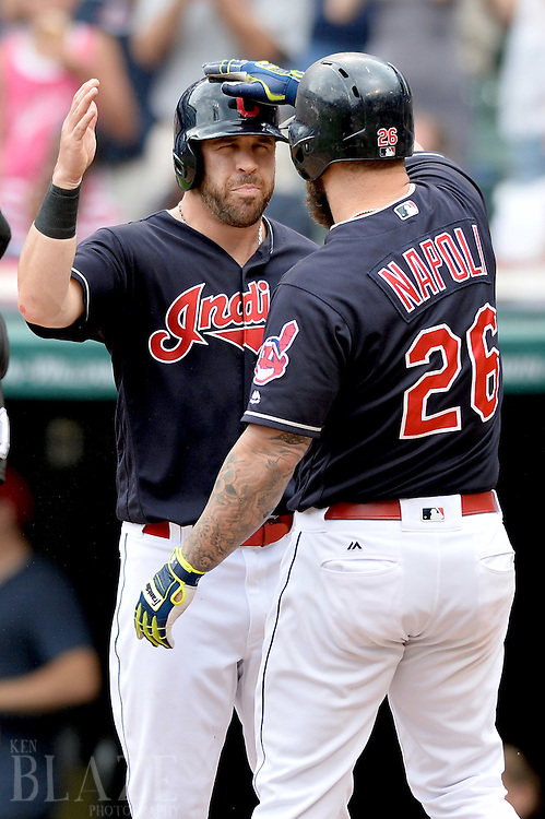 Jul 31, 2016; Cleveland, OH, USA; Cleveland Indians second baseman Jason Kipnis (22) and designated hitter Mike Napoli (26) celebrate after Napoli's home run during the third inning against the Oakland Athletics at Progressive Field. Mandatory Credit: Ken Blaze-USA TODAY Sports